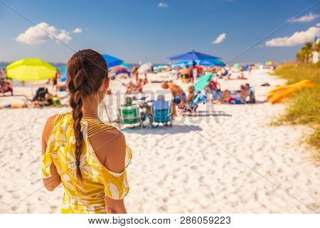 poster of Beach young woman lifestyle summer vacation girl from behind relaxing walking outside. Brunette with