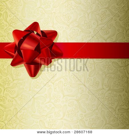 Christmas background made of gold paper with red ribbon