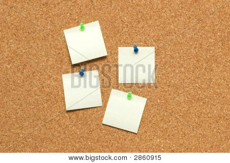 Yellow Notes On The Corkboard