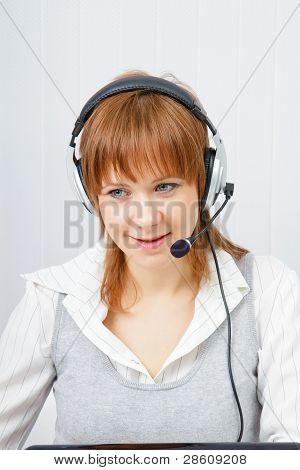 Girl In Headphones With A Microphone