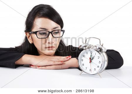Asian Businesswoman With Alarm Clock
