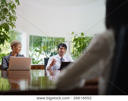 Business Man And Woman Talking In Meeting Room