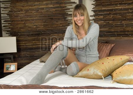 Woman In The Bed Laughing