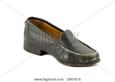 Alten grunge Womens Schuh isoliert auf weißem Hintergrund