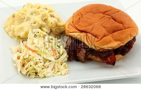 Bbq Sandwich With Slaw And Mashed Potatoes