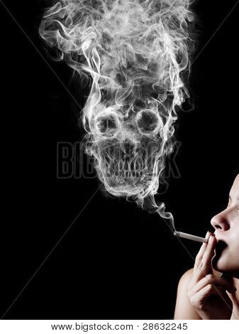 "woman smoking a cigarette. Of smoke formed skull dead, as a symbol of the dangers of smoking to health and imminent death of people. The concept ""smoking kills"". Isolated on a black background"