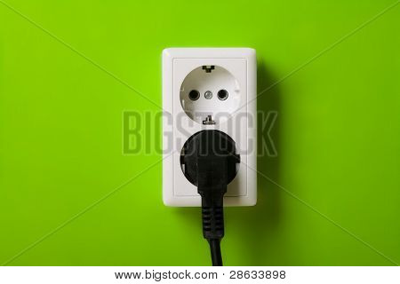 White electric socket on the wall.