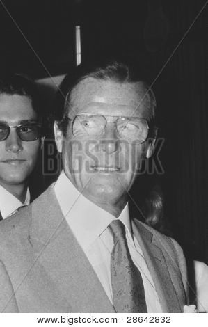 LONDON - MAY 27: Roger Moore, British actor, attends a celebrity event on May 27, 1989 in London. He is best known for his film roles as secret agent James Bond.