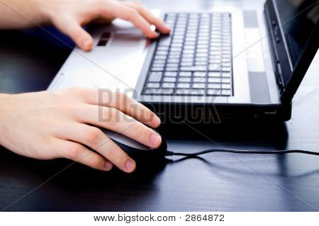Male Hands On Notebook Keyboard And Mouse
