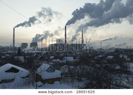 Thermal station smoke in sky at winter sunset