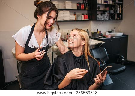 Professional Hairdresser With Scissors And