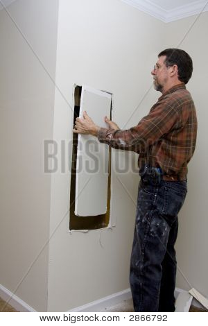 Electrician Cutting Access Hole