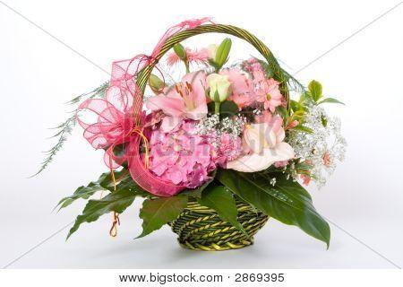 Various Flowers In Basket
