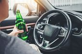 Drunk Man Driving A Car On The Road Holding Bottle Beer Dangerous Drunk Driving Concept poster