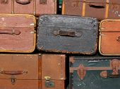 picture of old suitcase  - A background of old suitcases at a station - JPG