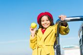 Little Girl Holding Organic Green Apple. Happy Child With Oraganic Fruit On Sunny Day. Small Baby En poster