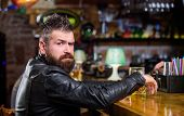 Brutal Hipster Bearded Man Sit At Bar Counter Drink Beer. Order Alcohol Drink. Bar Is Relaxing Place poster
