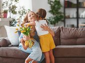 Happy Mothers Day! Children Congratulates Moms And Gives Her A Gift And Flowers . poster