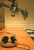 stock photo of recording studio  - Set of two microphones and headphones in a radio studio