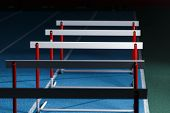 Row Of Hurdles For Sprint Training On The Lane poster