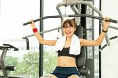 Beautiful Asians Young Fitness Woman Lifting Barbell. Sporty Woman Lifting Weights. Fit Girl Exercis poster