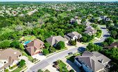 Suburb Neighborhood Cedar Park , Texas Aerial Drone View Above Texas Hill Country Homes On A Curved  poster