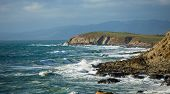 Panorama of waves crashing on the California coast near San Francisco. poster