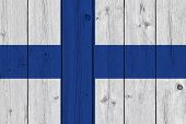Finland Flag Painted On Old Wood Plank. Patriotic Background. National Flag Of Finland poster