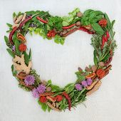 Heart shaped herb leaf and spice wreath with a selection of fresh herbs and spices with flowers on r poster