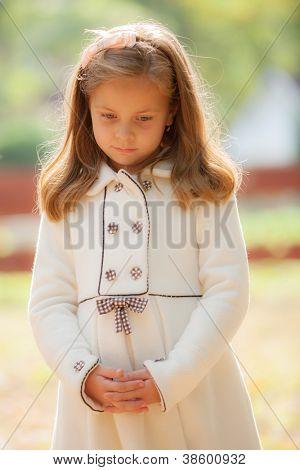 portrait of the sad girl in park