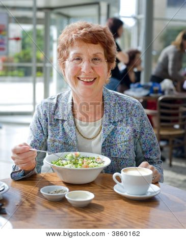 Senior Women Having Salad And Coffee