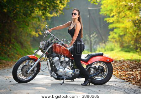 Attractive Girl  On A Motorbike