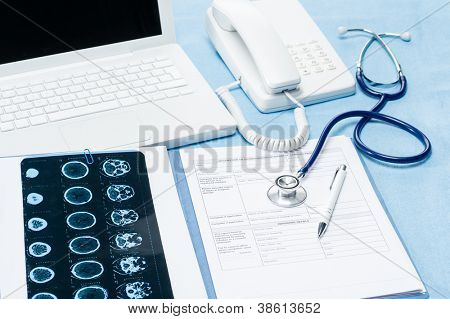 Medical report with xray in doctor' office on blue background