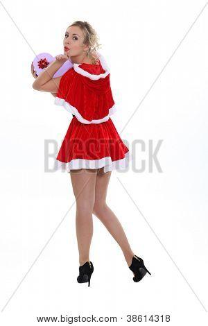 Cheeky Miss Santa looking over her shoulders