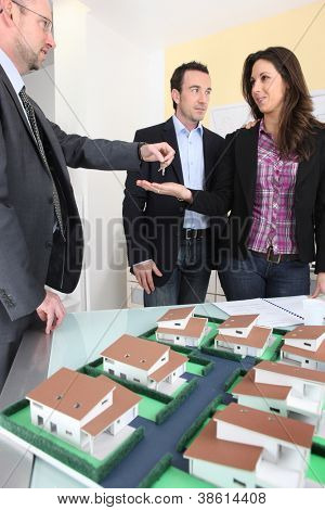 Architect handing over the keys to a new property owner