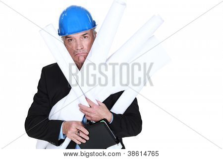 Pouting engineer carrying a stack of rolled-up drawings