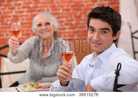 Man and grandmother in restaurant