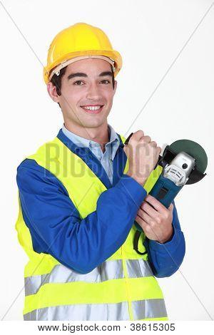 Tradesman holding an angle grinder