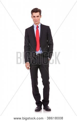 Confident modern business man with hand in pocket isolated on white