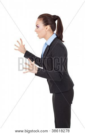 side view of a fierce business woman scaring someone