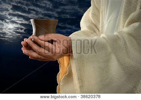 Jesus hands holding cup with night background