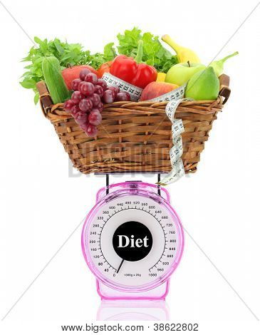 Diet concept. Kitchen scale with fruits and vegetables
