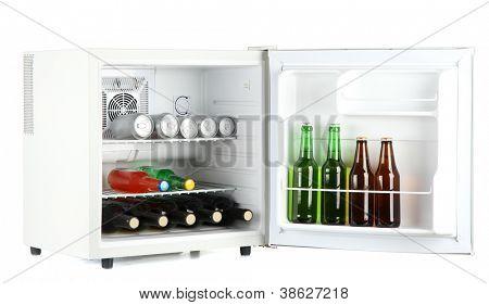 Mini fridge full of bottles of alcoholic beverages isolated on white