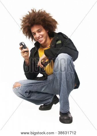 Afro style young man using a cell phone.