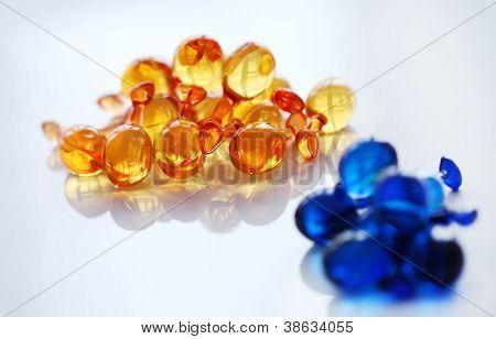 Close up of gelatin pills over glass surface