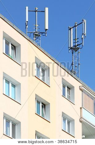 Two transmitters for mobile technology on a roof. Electronic smog danger. Environmental concept.