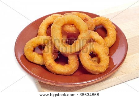 a plate with spanish calamares a la romana, squid rings breaded and fried