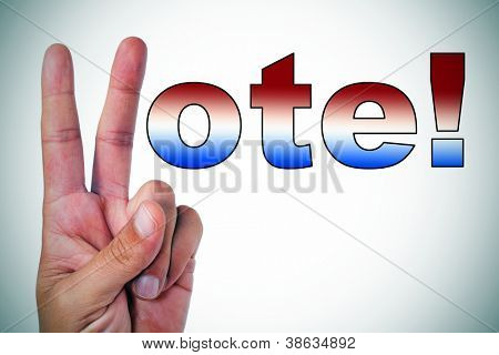 a man hand making the V sign to complete the sentence vote! written with the colors of the american flag