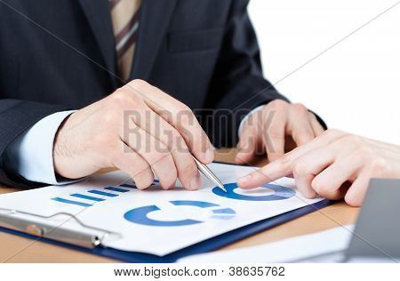Close up shot of hands of business people sitting at the table with documents, white background