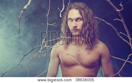 Portrait of long haired man with spooky eyes, Halloween theme